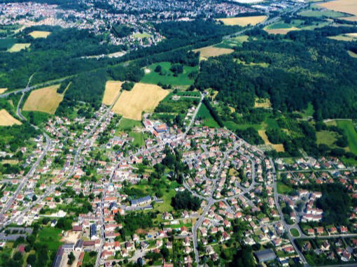 Aerial view over a town shows land available for building with the MAAP hybrid modular system